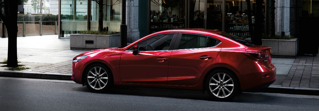 side view of red 2018 mazda3
