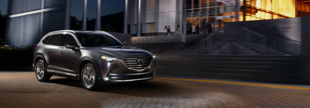 front and side view of silver 2019 mazda cx-9