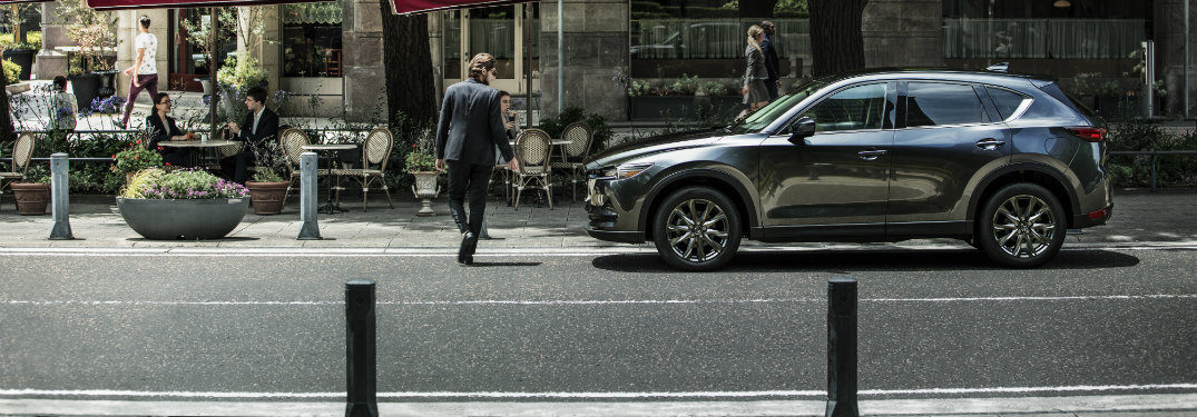 side view of gray 2019 mazda cx-5 on city street