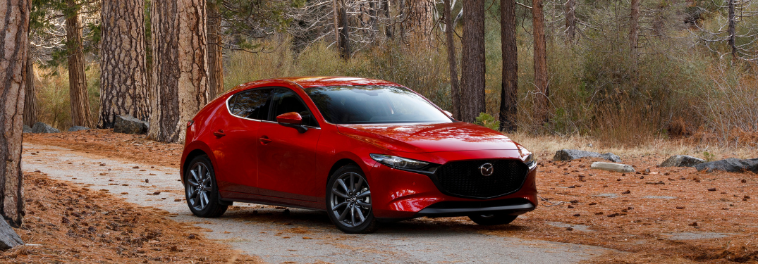 front and side view of red 2019 mazda3 hatchback