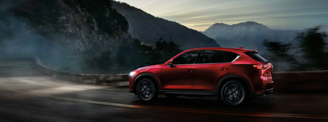 2018 Mazda CX-5 Side View of Red Exterior Driving near Mountains