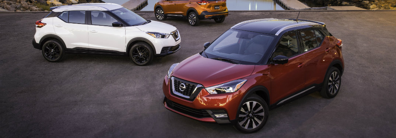 2018 Nissan Kicks in red in front of 2018 Nissan Kicks in white