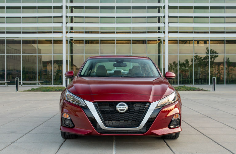 2019 Nissan Altima Edition ONE parked front facing the camera with a building behind it