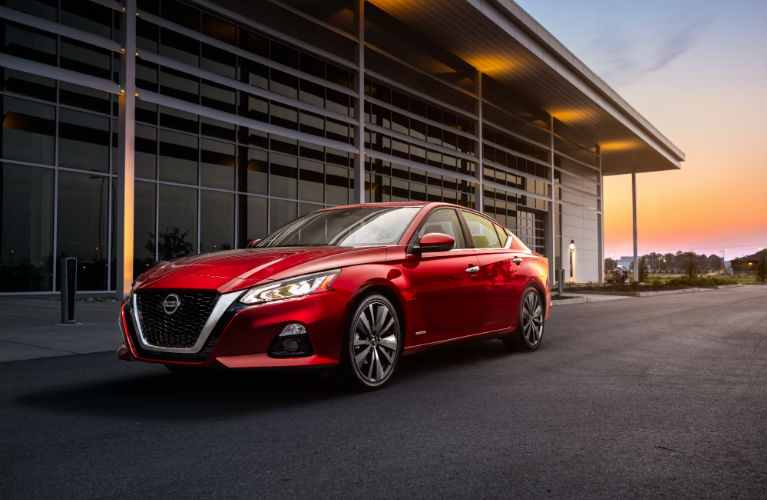 2019 Nissan Altima Edition ONE parked next to a builiding with the sun setting in the background