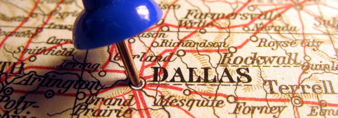 Road Trip Destinations in Texas with an image of a pin marking Dallas, TX on a map