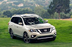2018 Nissan Pathfinder parked in a grass field