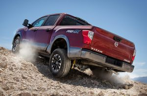2018 Nissan Titan driving up a rock and dirt path