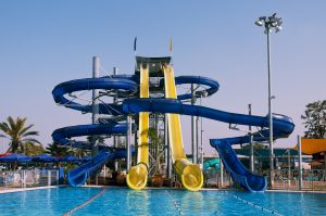 Water park view , with slides and swimming pool .