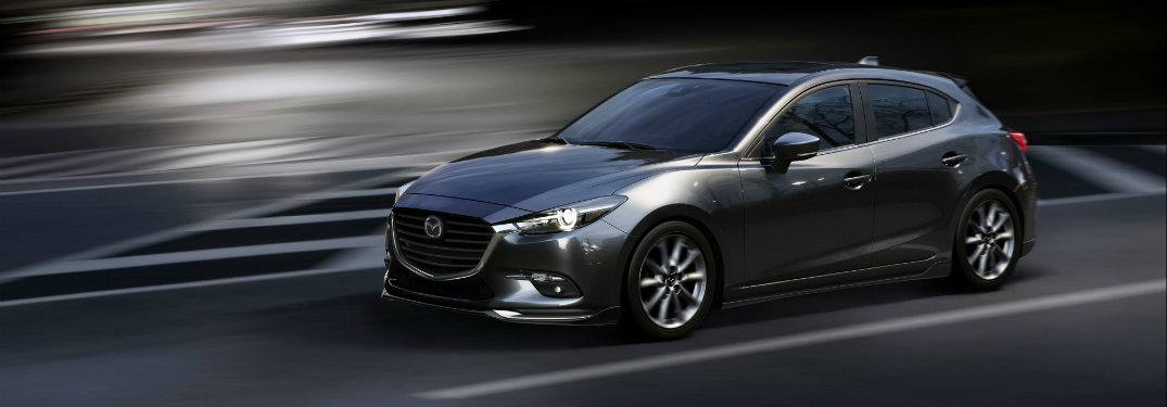 dark gray mazda3 driving at night