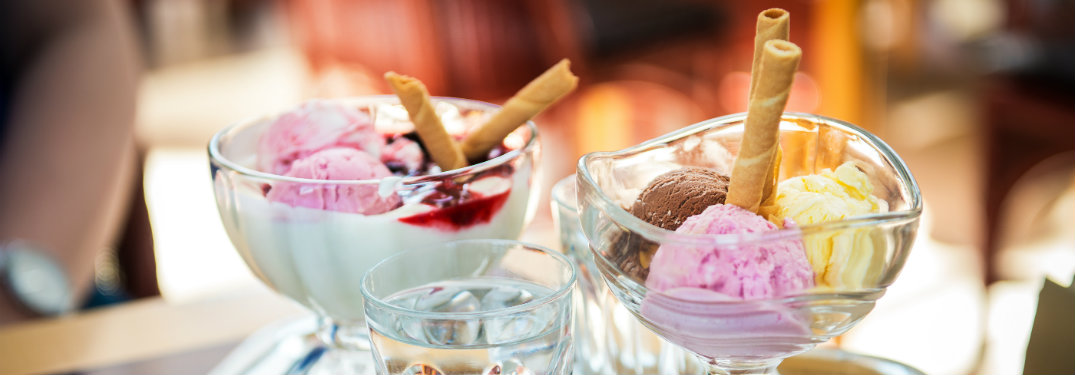glass dishes with colorful scoops of ice cream