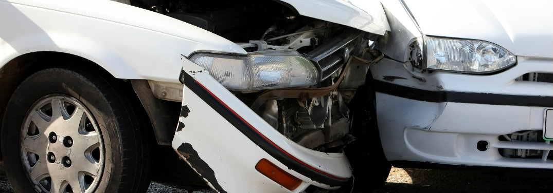 close up of two cars after a collision