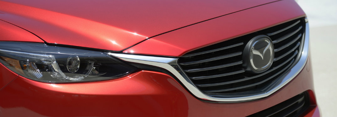 Red mazda3 grille and right headlight