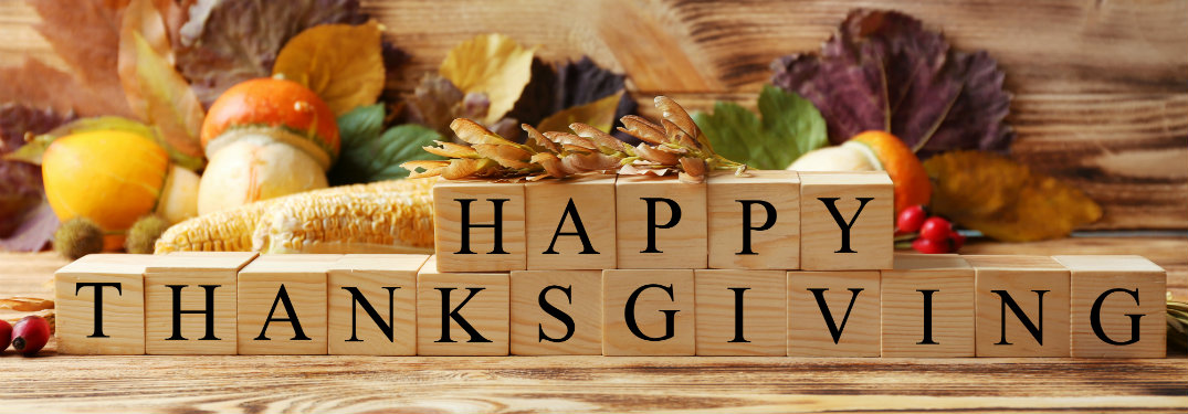 happy thanksgiving spelled with wooden blocks
