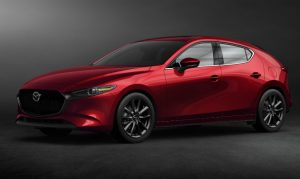 front left view of red mazda3 hatchback