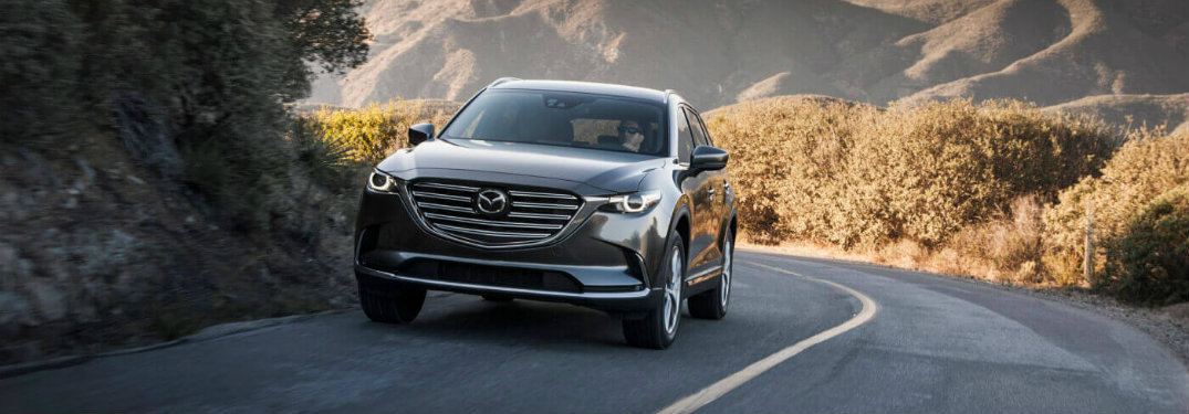 front view of gray mazda cx-9 driving up hill