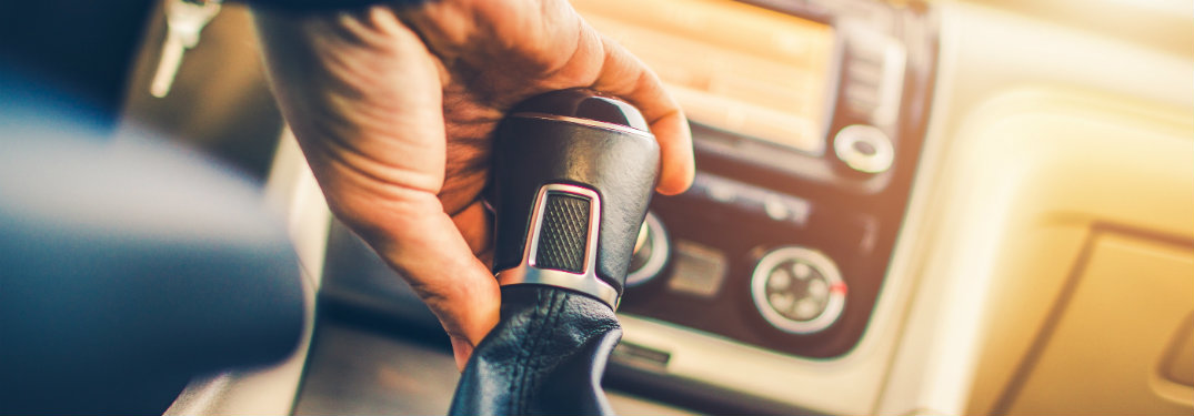 person's hand holding shifter