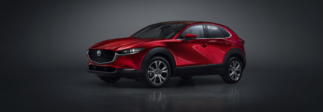 left front view of red mazda cx-30