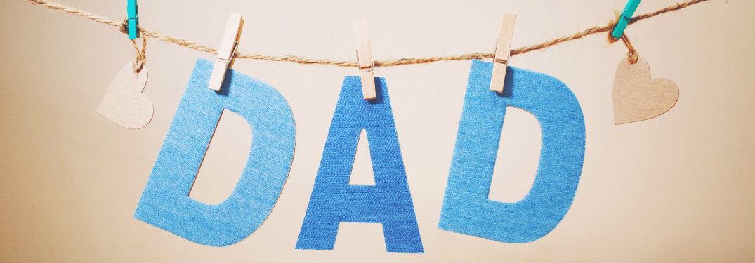 """""""Dad"""" letters hanging on string"""