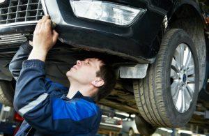 man working under car