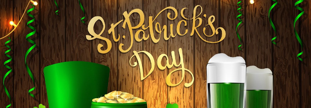 A cartoon banner for St. Patrick's Day with a pot of gold, green hat, and green beer with green streamers.