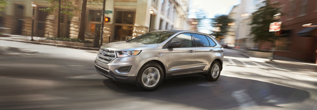 silver 2018 Ford Edge turning the corner of a city street