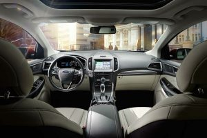 dashboard infotainment system and front passenger space of the 2018 Ford Edge