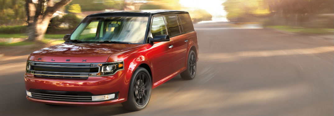red 2018 Ford Flex driving in a residential area