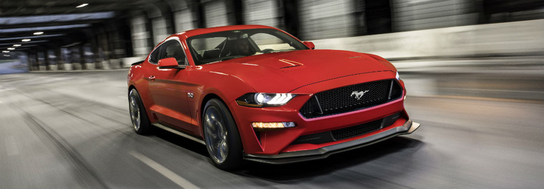 red 2018 Ford Mustang GT driving though a tunnel
