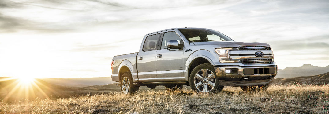 silver 2018 Ford F-150 parked on a hill with the sunrise in the background