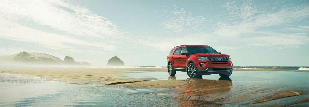 red 2018 Ford Explorer parked on a beach