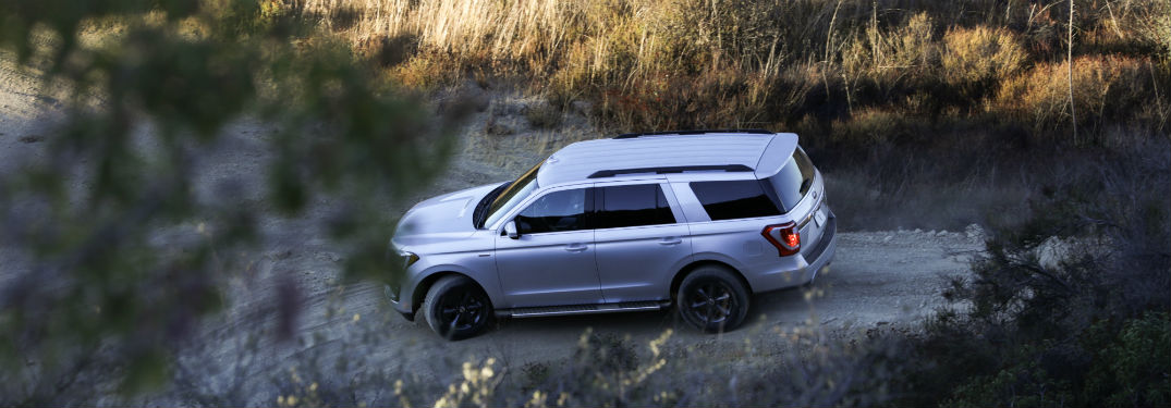 birds eye view of a silver 2018 Ford Expedition driving off-road