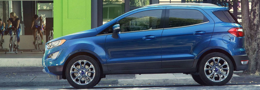 side view of a blue 2018 Ford EcoSport parked on a city street
