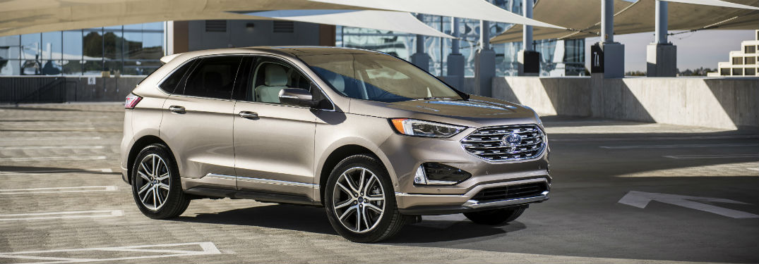 side view of a silver 2019 Ford Edge Titanium