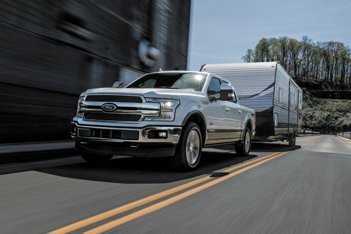 white 2018 Ford F-150 Diesel towing an RV_o - Akins Ford
