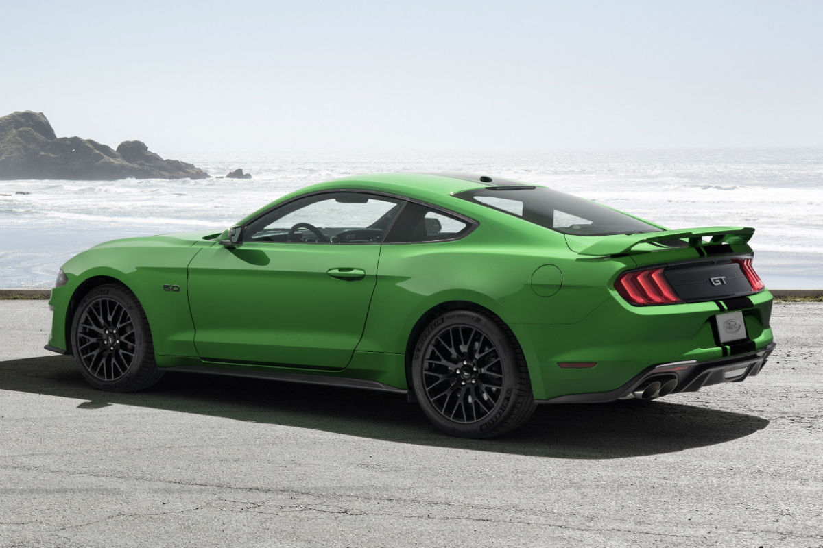 Side View Of A Need For Green Exterior Colored  Ford Mustang Gt Parked On A Beach_o Akins Ford