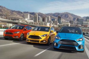 three 2018 Ford Focus models driving down the road side by side