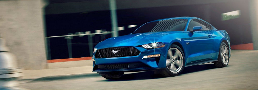side view of a blue 2019 Ford Mustang