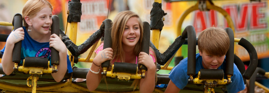 kids riding a ride at the Gwinnett County Fair