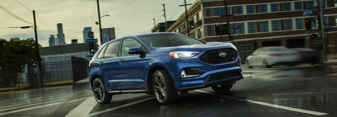 side view of a blue 2019 Ford Edge