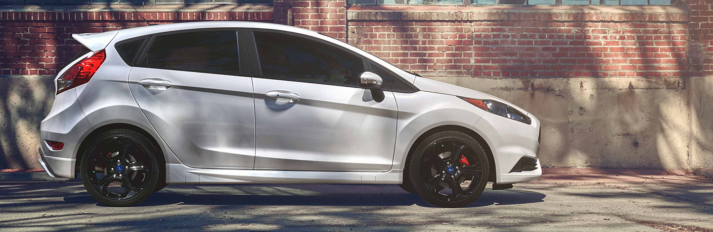 2019 Ford Fiesta on side of road by brick wall