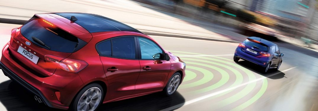 Ford Focus on road with Adaptive Cruise Control graphic