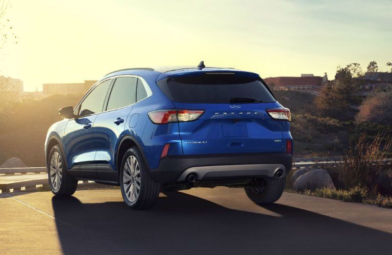 2020 Ford Escape driving down sunny road