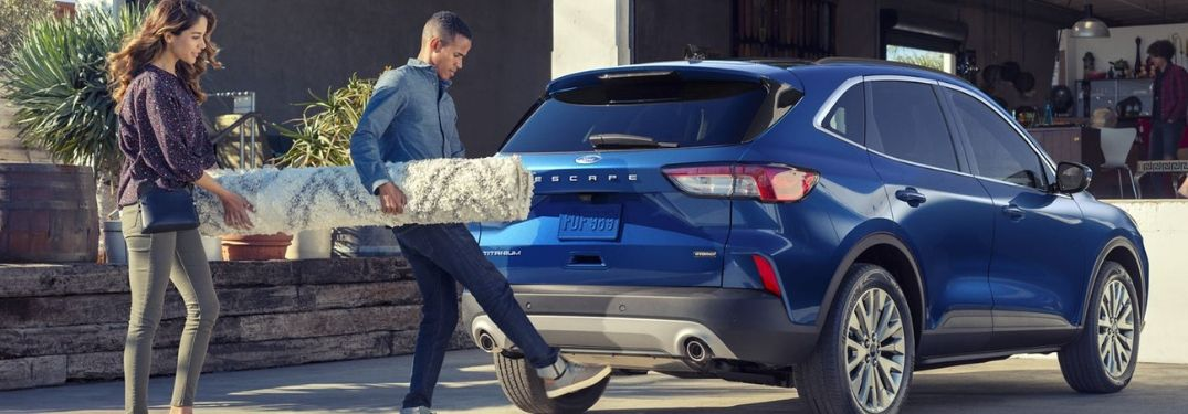 2020 Ford Escape with young couple loading rug