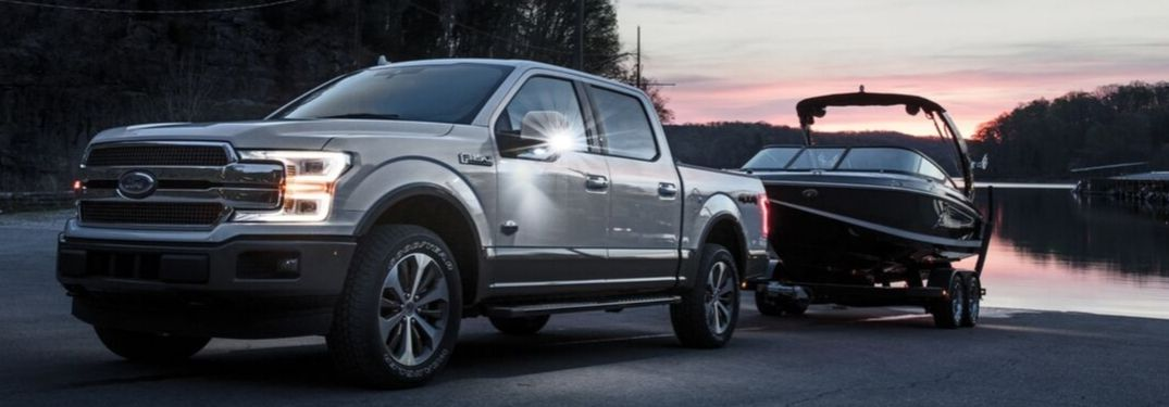 2020 Ford F-150 towing a boat at sunset