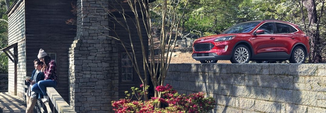 2020 Ford Escape parked on platform by young couple