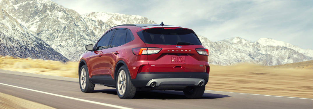 2020 Ford Escape driving down road by mountain scenery
