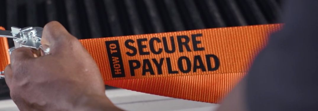 "Truck Life ratchet strap with ""How to Secure Payload"" text"