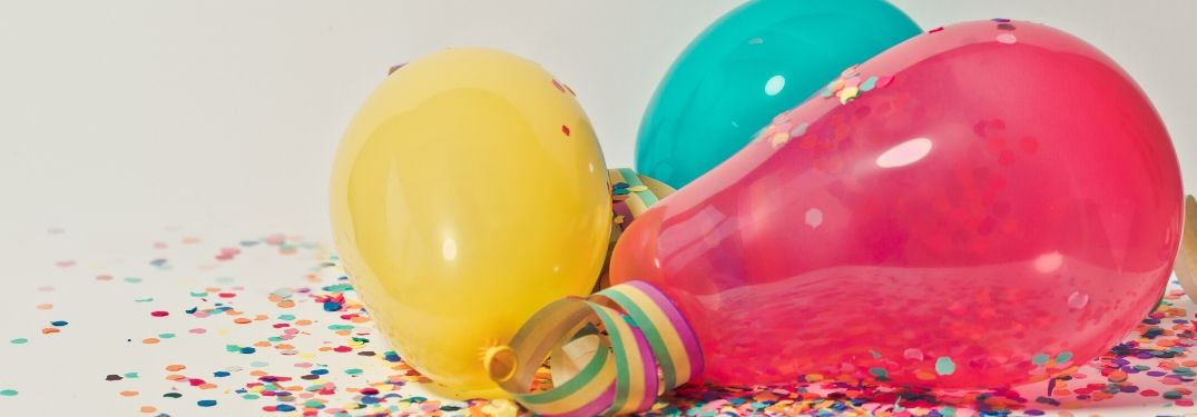 colorful balloons and confetti