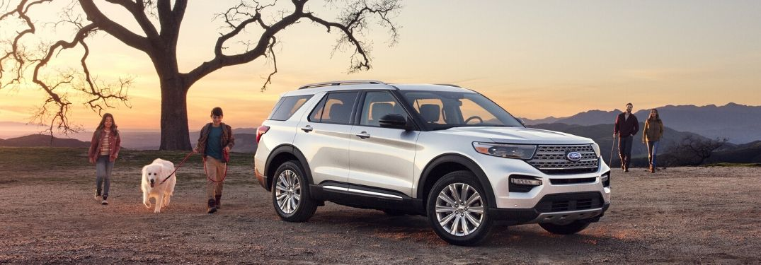 2020 Ford Explorer Hybrid on field with family