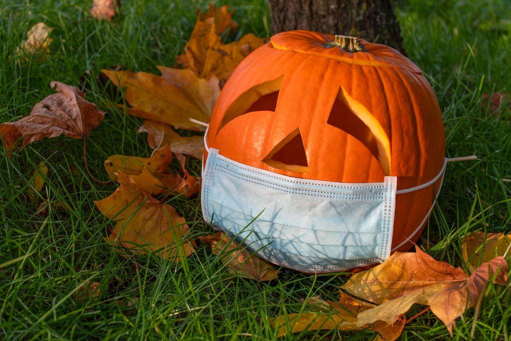 Halloween pumpkin wearing surgical mask